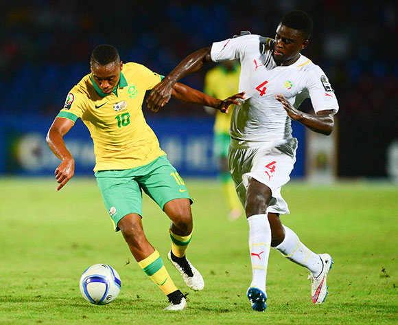 Sibusiso Vilakazi of South Africa and Alfred Ndiaye of Senegal during the 2015 Africa Cup of Nations football match between South Africa and Senegal at the Mongomo Stadium in Mongomo, Equatorial Guinea on 23 January 2015 ©Barry Aldworth/BackpagePix