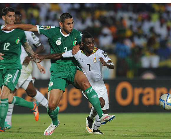 Faouzi Ghoulam of Algeria battles with Christian Atsu of Ghana   during of the 2015 Africa Cup of Nations match between Ghana and Senegal at Mongomo Stadium, Equatorial Guinea on 23 January 2015 Pic Sydney Mahlangu/BackpagePix