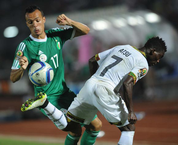 Foued Kadir of Algeria battles with Christian Atsu of Ghana in Mongomo