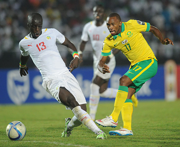 Bernard Parker of South Africa is tackled by Cheikh Mbengue of Senegal    during of the 2015 Africa Cup of Nations match between South Africa and Senegal at Mongomo Stadium, Equatorial Guinea on 23 January 2015 Pic Sydney Mahlangu/BackpagePix