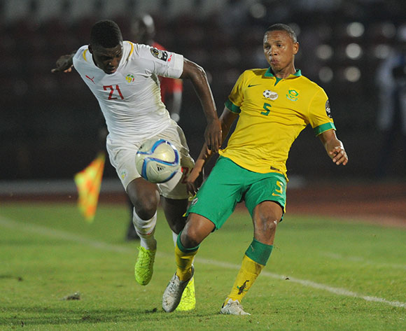 Andile Jali of South Africa battles with Lamine Gassama of Senegal   during of the 2015 Africa Cup of Nations match between South Africa and Senegal at Mongomo Stadium, Equatorial Guinea on 23 January 2015 Pic Sydney Mahlangu/BackpagePix