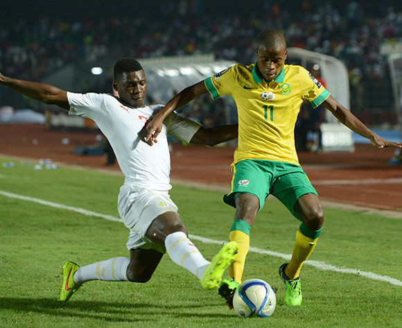 Thabo Matlaba of South Africa  battles with Lamine Gassama of Senegal   during of the 2015 Africa Cup of Nations match between South Africa and Senegal at Mongomo Stadium, Equatorial Guinea on 23 January 2015 Pic Sydney Mahlangu/BackpagePix