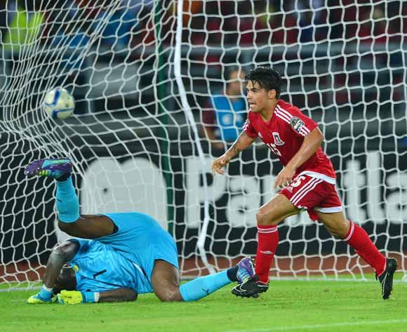 Ivan Edu Salvador of Equatorial Guinea scores goal past Didier Ebang Ovono of Gabon during the 2015 Africa Cup of Nations football match between Gabon and Equatorial Guinea at Bata Stadium, Bata, Equatorial Guinea on 25 January 2015
