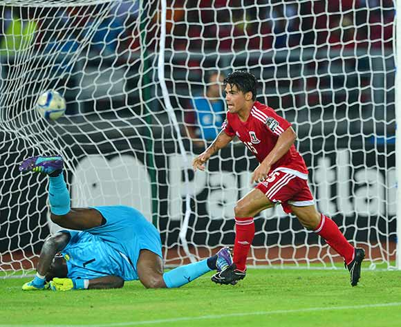 Ivan Edu Salvador of Equatorial Guinea scores goal past Didier Ebang Ovono of Gabon. Did the black magic work in that game?