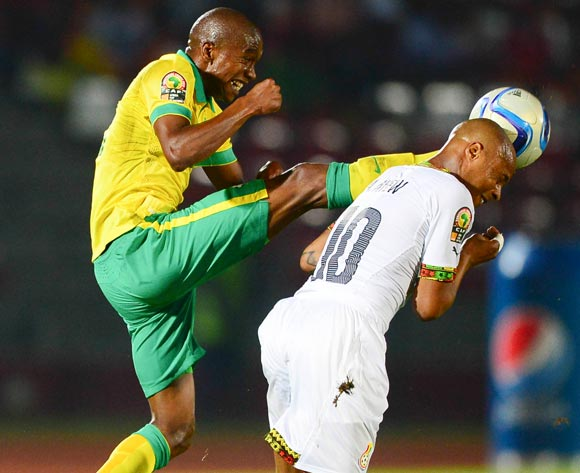 Anele Ngcongca of South Africa and Andre Ayew of Ghana during the 2015 Africa Cup of Nations football match between South Africa and Ghana at the Mongomo Stadium in Mongomo, Equatorial Guinea on 27 January 2015