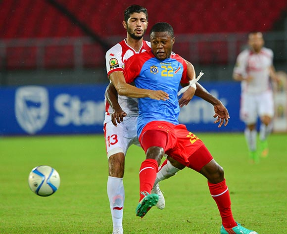 Chancel Mbemba of DR Congo shields ball from Ferjani Sassi of Tunisia
