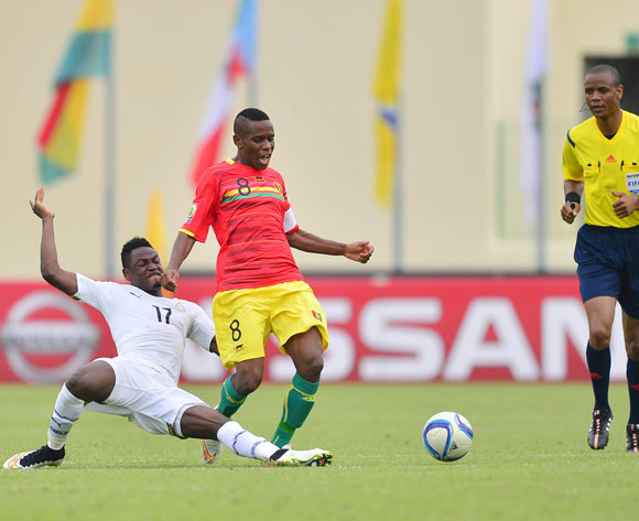 Abdul Baba Rahman of Ghana (L) and Ibrahima Traore of Guinea (R) during the 2015 Africa Cup of Nations football match between Ghana and Guinea at the Malabo Stadium in Malabo, Equatorial Guinea on 1 February 2015