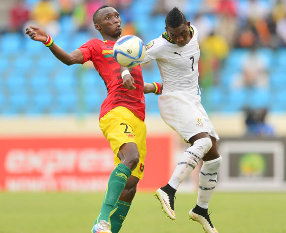 Djibril Tamsir Paye of Guinea  (L) and Christian Atsu of Ghana (R) during the 2015 Africa Cup of Nations football match between Ghana and Guinea at the Malabo Stadium in Malabo, Equatorial Guinea on 1 February 2015