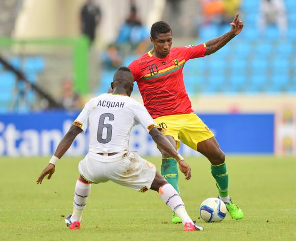 Afriyie Acquah of Ghana (L) and Kevin Constant of Guinea (R) during the 2015 Africa Cup of Nations football match between Ghana and Guinea at the Malabo Stadium in Malabo, Equatorial Guinea on 1 February 2015