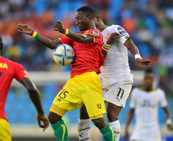 Naby Keita of Guinea (L) and Mubarak Wakaso of Ghana  (R) during the 2015 Africa Cup of Nations football match between Ghana and Guinea at the Malabo Stadium in Malabo, Equatorial Guinea on 1 February 2015