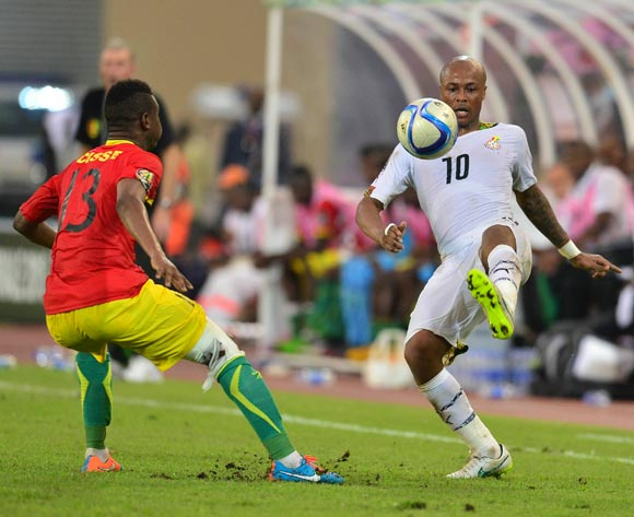 Abdoulaye Cisse of Guinea (L) and Andre Ayew of Ghana (R) during the 2015 Africa Cup of Nations football match between Ghana and Guinea at the Malabo Stadium in Malabo, Equatorial Guinea on 1 February 2015