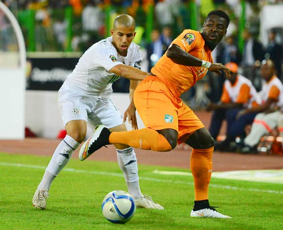 Yacine Brahimi of Algeria (L) and Serge Aurier of Ivory Coast (R) during the 2015 Africa Cup of Nations football match between Ivory Coast and Algeria at the Malabo Stadium in Malabo, Equatorial Guinea on 1 February 2015