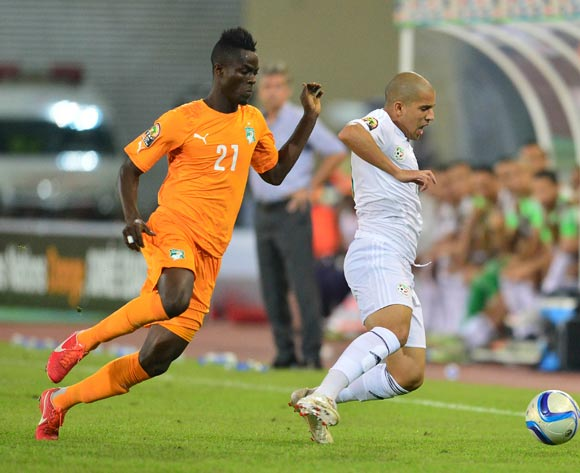 Eric Bailly of Ivory Coast (L) and Sofiane Feghouli of Algeria (R) during the 2015 Africa Cup of Nations football match between Ivory Coast and Algeria at the Malabo Stadium in Malabo, Equatorial Guinea on 1 February 2015