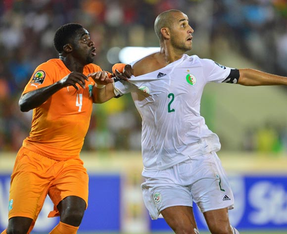 Kolo Toure of Ivory Coast (L) and Madjid Bouguerra of Algeria (R) during the 2015 Africa Cup of Nations football match between Ivory Coast and Algeria at the Malabo Stadium in Malabo, Equatorial Guinea on 1 February 2015