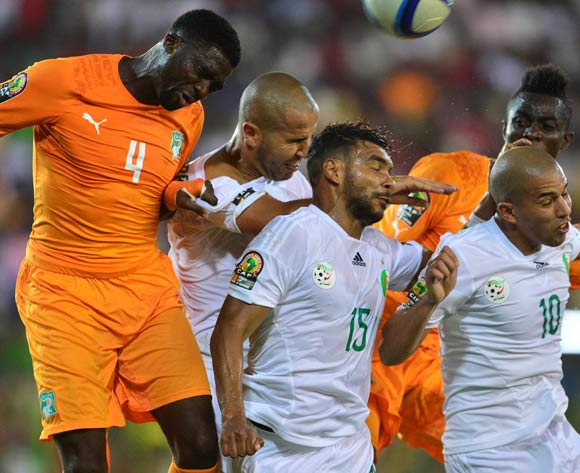 Kolo Toure of Ivory Coast (l) competes against Madjid Bouguerra (cl) El Arabi Soudani (cr) and Sofiane Feghouli of Algeria (r) during the 2015 Africa Cup of Nations football match between Ivory Coast and Algeria at the Malabo Stadium in Malabo, Equatorial Guinea on 1 February 2015