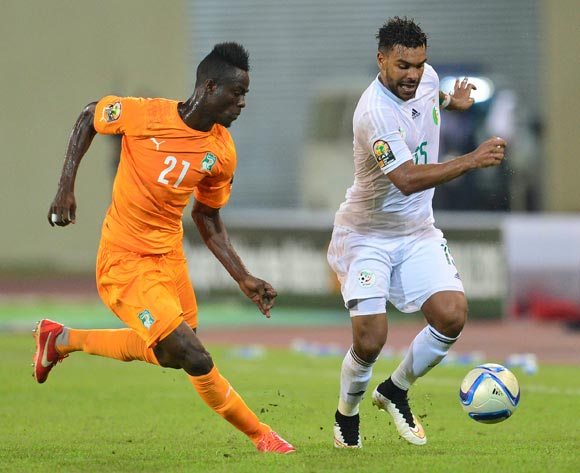 Eric Bailly of Ivory Coast (L) and El Arabi Soudani of Algeria (R) during the 2015 Africa Cup of Nations football match between Ivory Coast and Algeria at the Malabo Stadium in Malabo, Equatorial Guinea on 1 February 2015