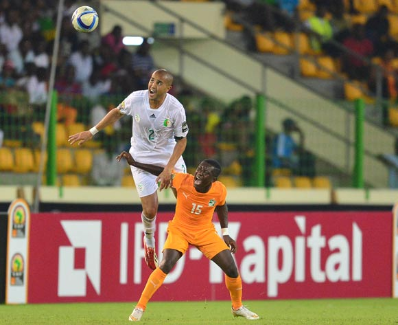 Madjid Bouguerra of Algeria (L) and Max Gradel of Ivory Coast (R) during the 2015 Africa Cup of Nations football match between Ivory Coast and Algeria at the Malabo Stadium in Malabo, Equatorial Guinea on 1 February 2015