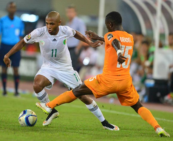 Yacine Brahimi of Algeria (L) and Max Gradel of Ivory Coast (R) during the 2015 Africa Cup of Nations football match between Ivory Coast and Algeria at the Malabo Stadium in Malabo, Equatorial Guinea on 1 February 2015