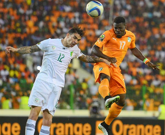 Carl Medjani of Algeria and Serge Aurier of Ivory Coast during the 2015 Africa Cup of Nations football match between Ivory Coast and Algeria at the Malabo Stadium in Malabo, Equatorial Guinea on 1 February 2015