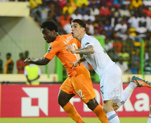 Wilfried Bony of Ivory Coast and Carl Medjani of Algeria watch as Wilfried Bony's header enters the net during the 2015 Africa Cup of Nations football match between Ivory Coast and Algeria at the Malabo Stadium in Malabo, Equatorial Guinea on 1 February 2015