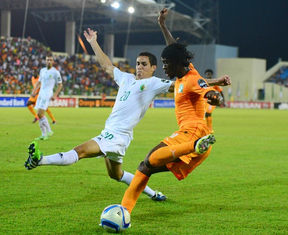 Aissa Mandi of Algeria and Gervinho of Ivory Coast during the 2015 Africa Cup of Nations football match between Ivory Coast and Algeria at the Malabo Stadium in Malabo, Equatorial Guinea on 1 February 2015