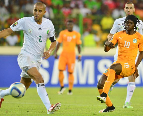 Madjid Bouguerra of Algeria and Gervinho of Ivory Coast during the 2015 Africa Cup of Nations football match between Ivory Coast and Algeria at the Malabo Stadium in Malabo, Equatorial Guinea on 1 February 2015