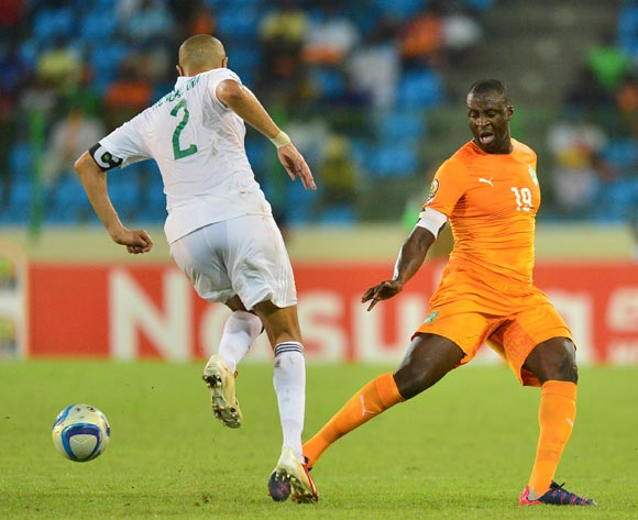 Madjid Bouguerra of Algeria and Yaya Toure of Ivory Coast during the 2015 Africa Cup of Nations football match between Ivory Coast and Algeria at the Malabo Stadium in Malabo, Equatorial Guinea on 1 February 2015