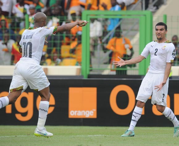 Kwesi Appiah of Ghana (2) celebrates his team second goal with Andre Ayew of Ghana (10) during of the 2015 Africa Cup of Nations Quarter Final match between Ghana and Guinea at Malabo Stadium, Equatorial Guinea on 01 February 2015