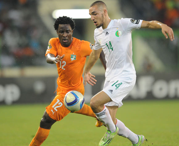 Wilfried Bony of Ivory Coast  challenges Nabil Bentaleb of Algeria during of the 2015 Africa Cup of Nations Quarter Final match between Ivory Coast and Algeria at Malabo Stadium, Equatorial Guinea on 01 February 2015