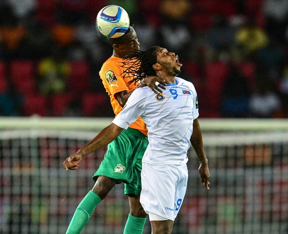 Eric Bailly of Ivory Coast (L) and Diedonnei Mbokani of DR Congo (R)during the 2015 Africa Cup of Nations Semifinal football match between DR Congo and Ivory Coast at the Bata Stadium in Bata, Equatorial Guinea on 4 February 2015