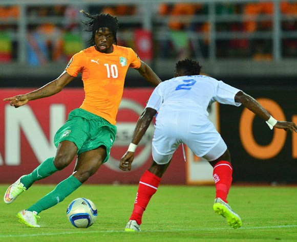 Gervinho of Ivory Coast (L) and Issampa Djos of DR Congo (R) during the 2015 Africa Cup of Nations Semifinal football match between DR Congo and Ivory Coast at the Bata Stadium in Bata, Equatorial Guinea on 4 February 2015