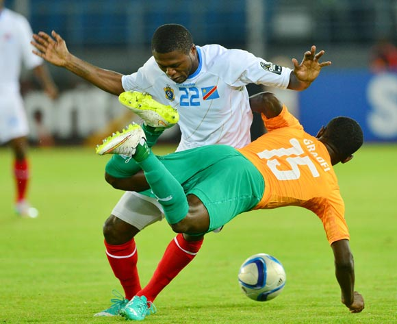 Max Gradel of Ivory Coast fouled by Chancel Mbemba of DR Congo during the 2015 Africa Cup of Nations semifinal football match between DR Congo and Ivory Coast at the Bata Stadium, Bata, Equatorial Guinea on 4 February  2015