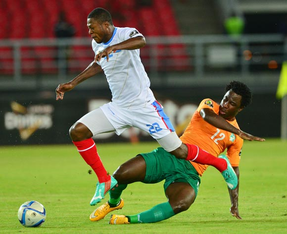 Chancel Mbemba of DR Congo (l) tackled by Wilfried Bony of Ivory Coast (r) during the 2015 Africa Cup of Nations semifinal football match between DR Congo and Ivory Coast at the Bata Stadium, Bata, Equatorial Guinea on 4 February  2015