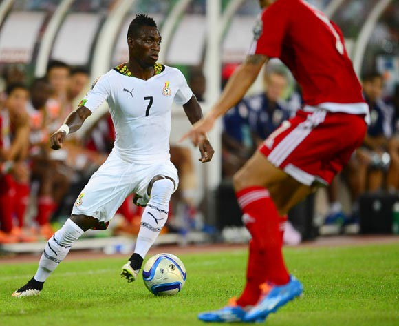Christian Atsu of Ghana (L) and Reuban Belima of Equatorial Guinea (R) during the 2015 Africa Cup of Nations Semifinal football match between Ghana and Equatorial Guinea at the Malabo Stadium in Malabo, Equatorial Guinea on 5 February 2015