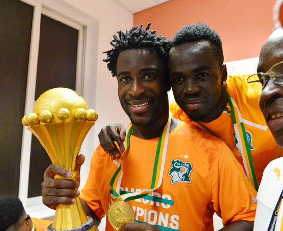 Wilfried Bony of Ivory Coast (l) and Cheik Tiote of Ivory Coast (r) celebrate with trophy  in change room during  the 2015 Africa Cup of Nations football Final match between Ivory Coast and Ghana at the Bata Stadium, Bata, Equatorial Guinea on 8 February  2015