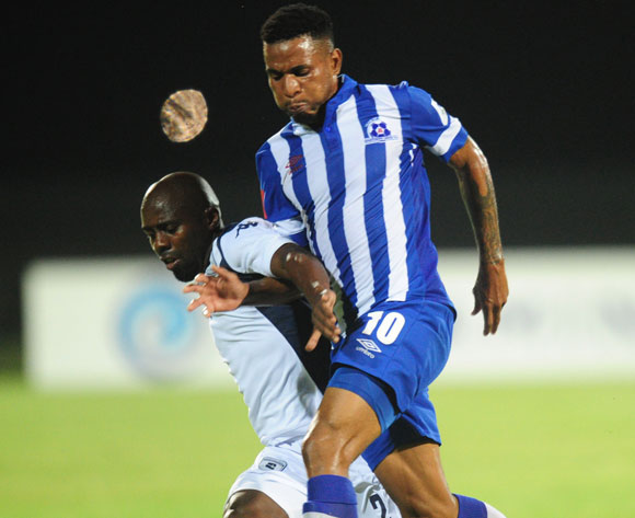 Sandile Zuke of Bidvest Wits battles Nhlanhla Vilakazi of Maritzburg United during the Absa Premiership 2014/15 football match between Maritzburg United and Bidvest Wits at the Harry Gwala Stadium in Pietermaritzburg , Kwa-Zulu Natal on the 10th of February 2015