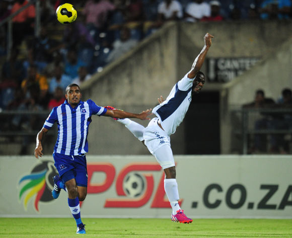 Thulani Hlatshwayo of Bidvest Wits and Deolin Mekoa of Maritzburg United during the Absa Premiership 2014/15 football match between Maritzburg United and Bidvest Wits at the Harry Gwala Stadium in Pietermaritzburg , Kwa-Zulu Natal on the 10th of February 2015