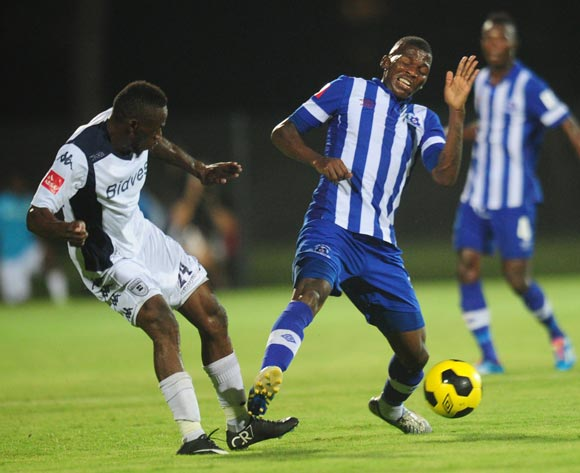 Onismor Bhasera of Bidvest Wits battles Thamsanqa Mkhize of Maritzburg United during the Absa Premiership 2014/15 football match between Maritzburg United and Bidvest Wits at the Harry Gwala Stadium in Pietermaritzburg , Kwa-Zulu Natal on the 10th of February 2015