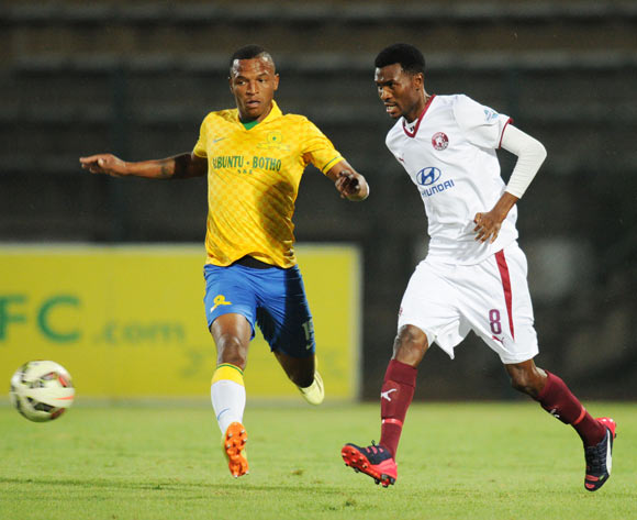 Lucky Baloyi of Moroka Swallows challenged by Mzikayise Mashaba of Mamelodi Sundowns during the Absa Premiership 2014/15 match between Mamelodi Sundowns and Moroka Swallows at the Lucas Moripe Stadium, Attridgeville on the 10 February 2015