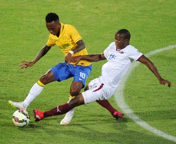 Teko Modise of Mamelodi Sundowns tackled by Lantshene Phalane of Moroka Swallows during the Absa Premiership 2014/15 match between Mamelodi Sundowns and Moroka Swallows at the Lucas Moripe Stadium, Attridgeville on the 10 February 2015