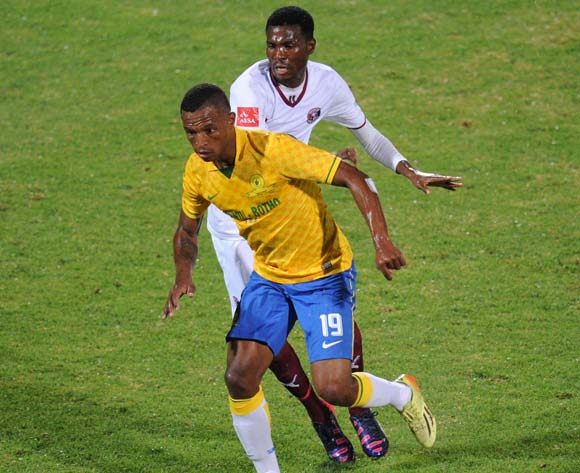 Mzikayise Mashaba of Mamelodi Sundowns challenged by Lucky Baloyi of Moroka Swallows during the Absa Premiership 2014/15 match between Mamelodi Sundowns and Moroka Swallows at the Lucas Moripe Stadium, Attridgeville on the 10 February 2015