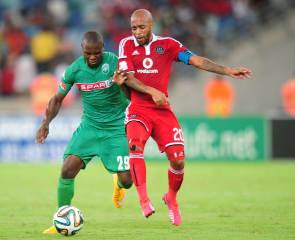 Bornwell Mwape of AmaZulu battles Oupa Manyisa of Orlando Pirates during the Absa Premiership 2014/15 football match between AmaZulu and Orlando Pirates at the Moses Mabhida Stadium in Durban Kwa-Zulu Natal on the 11th of February 2015