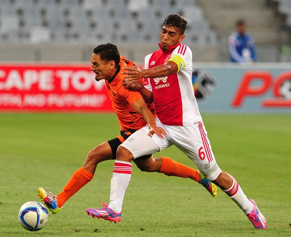 Travis Graham of Ajax Cape Town shrugs off Cole Alexander of Polokwane City during the Absa Premiership 2014/15 game between Ajax Cape Town and Polkwane City at Cape Town Stadium, Cape Town on 11 February 2015