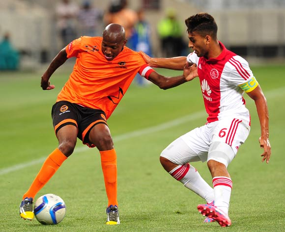 Jabulani Maluleke of Polokwane City takes on Travis Graham of Ajax Cape Town during the Absa Premiership 2014/15 game between Ajax Cape Town and Polkwane City at Cape Town Stadium, Cape Town on 11 February 2015