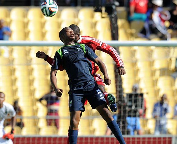 Rooi Mahamutsa of Orlando Pirates battles with Ndumiso Mabena of Platinum Stars during the Absa Premiership 2014/15 match between Platinum Stars and Orlando Pirates at the Royal Bafokeng Stadium, Rustenburg on the 14 February 2015  ©Muzi Ntombela/BackpagePix