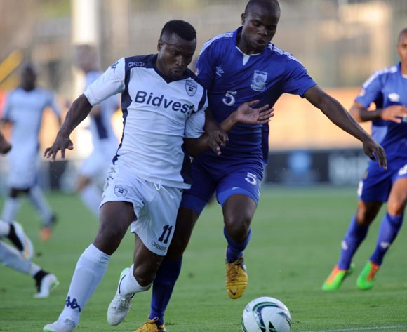 Christopher Katongo of Bidvest Wits battles with Machawe Dlamini of Royal Leopards during the CAF Confederation Cup match between Bidets Wits and Royal Leopards at Bidvest Stadium, Johannesburg on 14 February 2015