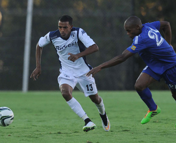 Sameehg Doutie of Bidvest Wits dribbles past Sikhumbuzo Ntimane of Royal Leopards  during the CAF Confederation Cup match between Bidets Wits and Royal Leopards at Bidvest Stadium, Johannesburg on 14 February 2015