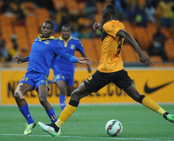 Boy Segolame of Township Rollers is closed down by Erick Mathoho of Kaizer Chiefs  during the CAF Champions League match between Kaizer Chiefs and Township Rollers at FNB Stadium, Johannesburg on 14 February 2015