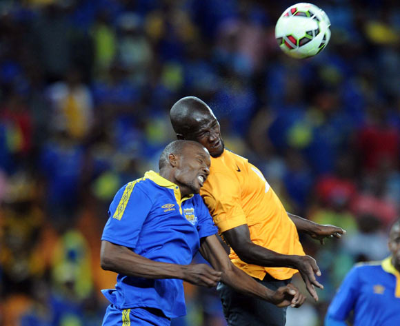 Ncenga Obuile of Township Rollers battles with Siphelele Mthembu of Kaizer Chiefs  during the CAF Champions League match between Kaizer Chiefs and Township Rollers at FNB Stadium, Johannesburg on 14 February 2015