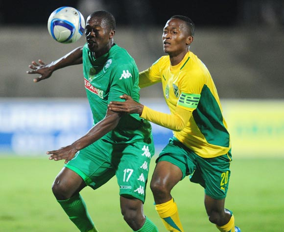Bonginkosi Ntuli of AmaZulu battles Matome Mathiane of Golden Arrows during the 2015 Nedbank Cup football match between AmaZulu and Golden Arrows at the Princess Magogo Stadium in Durban on the 20th of February 2015